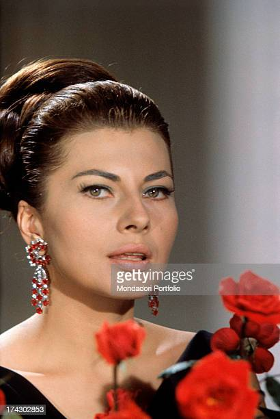 Princess of Iran Soraya the second wife and Queen Consort of the late Shah of Iran is posing in front of a piano in the elegant livingroom of her...