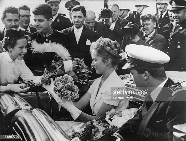 Princess Paola of Belgium and Prince Albert of Belgium later King Albert II of Belgium meet crowds gathered outside Brussels Town Hall whilst touring...
