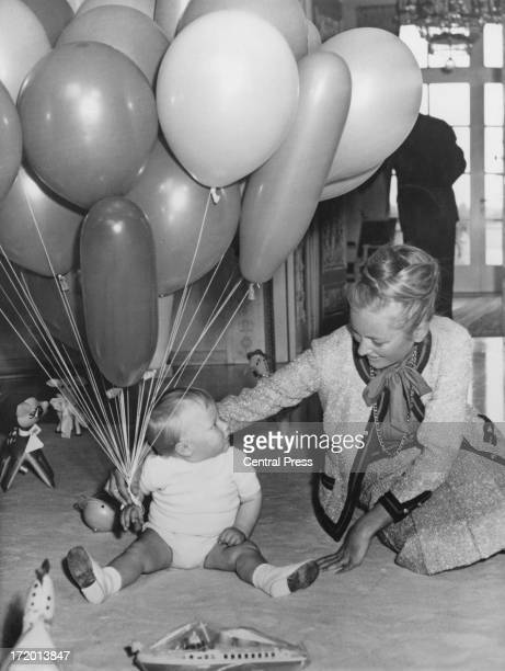Princess Paola of Belgium and Prince Albert of Belgium later King Albert II of Belgium celebrate the 1st birthday party of their son Prince Philippe...