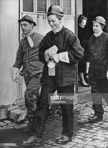 Princess Paola of Belgium wearing a miner's helmet and overalls on a visit to a colliery in Liege, Belgium, 24th March 1961.