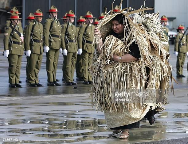 Princess Pilolevu walks past the guard of honour as she follows the hearse carrying her father, the late Tongan King Taufa'ahau Tupou IV at Whenuapai...