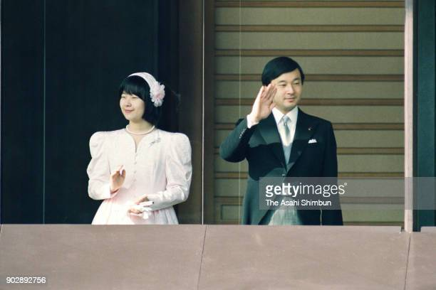 Princess Sayako and Crown Prince Naruhito wave to wellwishers from a balcony to celebrate the emperor's 59th birthday at the Imperial Palace on...