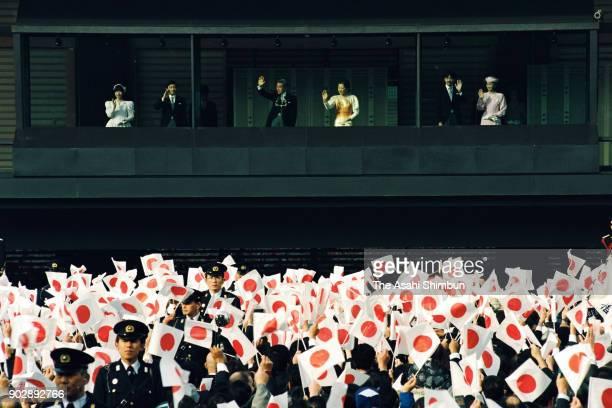Princess Sayako Crown Prince Naruhito Emperor Akihito Empress Michiko Prince Akishino and Princess Kiko of Akishino wave to wellwishers from a...
