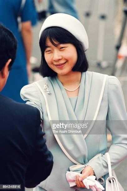 Princess Sayako welcomes Emperor Akihito and Empress Michiko at Haneda Airport on September 19 1993 in Tokyo Japan