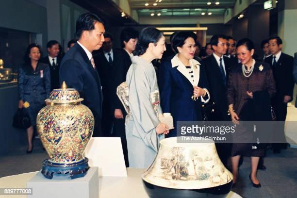Princess Sirikit of Thailand and Empress Michiko visit a Thai crafts exhibition at Takashimaya Department Store on April 8 1993 in Tokyo Japan