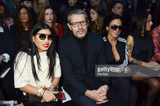 Princess Siriwanwaree of Tha•land Lambert Wilson and Sandra Zeitoun attend the John Galliano Front Row PFW F/W 2013 at Le Centorial on March 3 2013...
