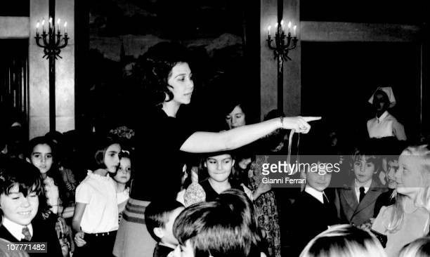 Princess Sofia of Greece prepares some games with some kids invited to the birthday of her daughter Elena in the Zarzuela Palace 21th December 1971...