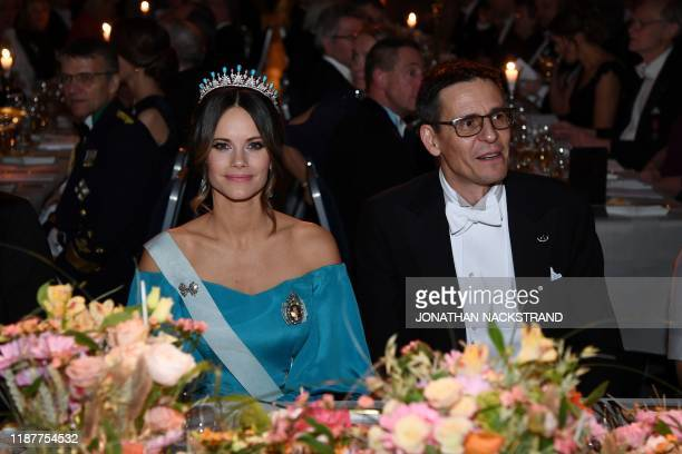 Princess Sofia of Sweden and Swiss astronomer and colaureate of the 2019 Nobel Prize in Physics Didier Queloz pose before a royal banquet to honour...