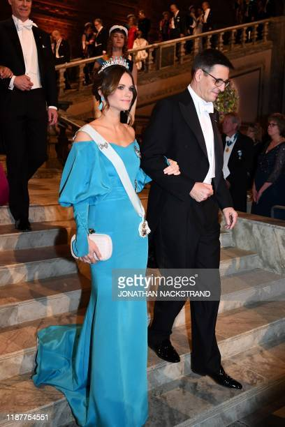 Princess Sofia of Sweden and Swiss astronomer and colaureate of the 2019 Nobel Prize in Physics Didier Queloz arrive for a royal banquet to honour...