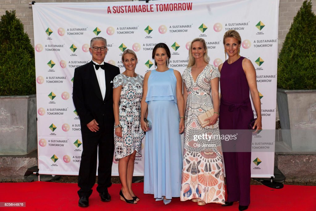 Princess Sofia of Sweden (R-2nd) together with Bo Nilsson (R-1st) and Susanne Johansen (L), Secretary General for 'A Sustainable Tomorrow' and spouses pose during arrival to the charity party in support of 'A Sustainable Tomorrow' oragnisation on August 2, 2017 in Bastad, Sweden.