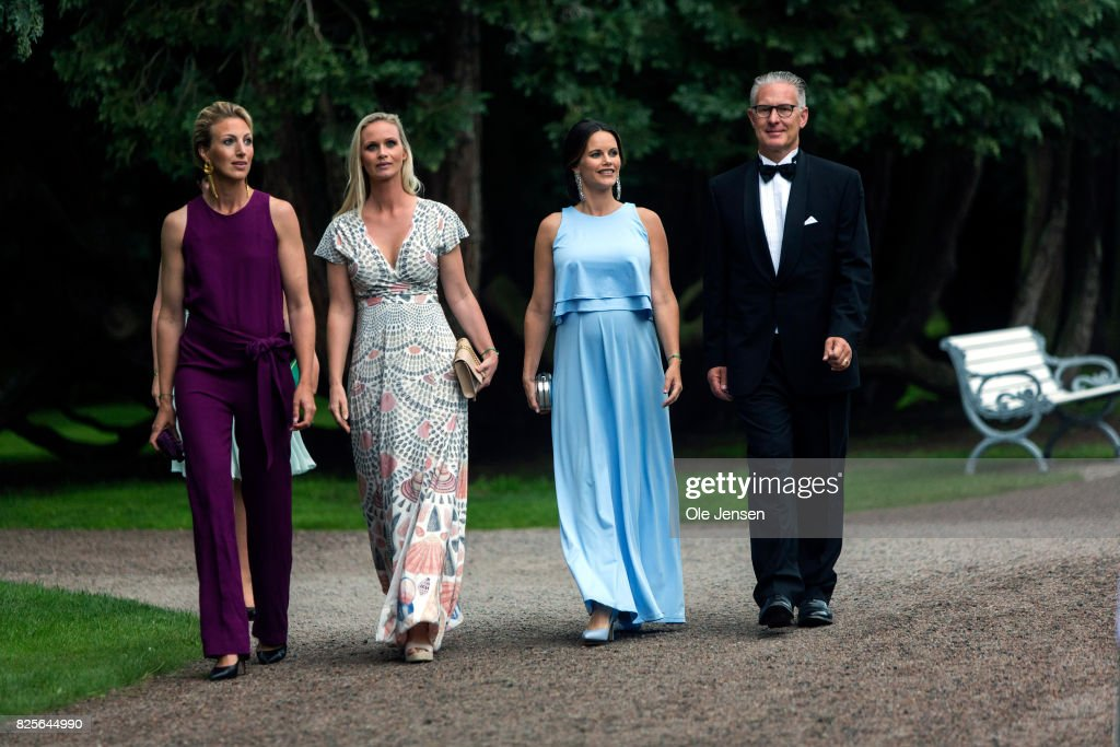 Princess Sofia of Sweden (R-2nd) together with Bo Nilsson (R-1st) and Susanne Johansen (L), Secretary General for 'A Sustainable Tomorrow' and spouses arrives to the charity party in support of 'A Sustainable Tomorrow' oragnisation on August 2, 2017 in Bastad, Sweden.