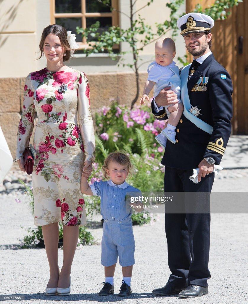 Princess Sofia of Sweden,Prince Alexander of Sweden and Prince Carl Phillip of Sweden holding Prince Gabriel of Sweden attend the christening of Princess Adrienne of Sweden at Drottningholm Palace Chapel on June 8, 2018 in Stockholm, Sweden.