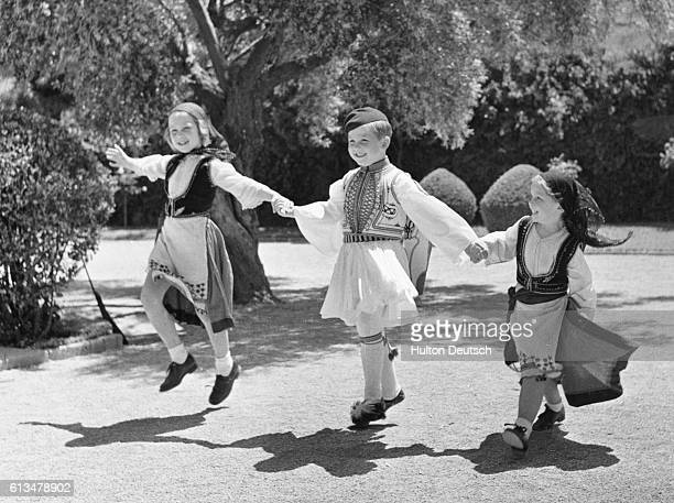 Princess Sophia aged eight Prince Constantine aged six and fiveyearold Princess Irene the children of King Paul and Queen Frederika of Greece play in...
