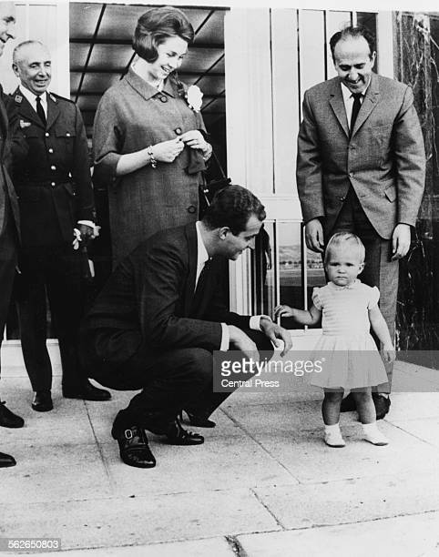 Princess Sophia of Greece and her husband Don Juan Carlos with their young daughter Princess Frederika at Madrid Airport June 8th 1965