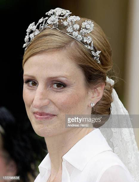 Princess Sophie of Prussia smiles after the religious wedding ceremony to Georg Friedrich Ferdinand Prince of Prussia in the Friedenskirche Potsdam...