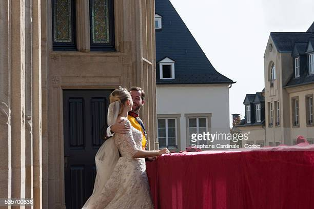 Princess Stephanie of Luxembourg and Crown Prince Guillaume of Luxembourg wave to the crowds from the balcony of the Grand-Ducal Palace following...