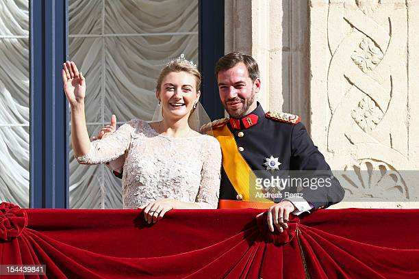 Princess Stephanie of Luxembourg and Prince Guillaume of Luxembourg wave to the crowds from the balcony of the GrandDucal Palace following the...