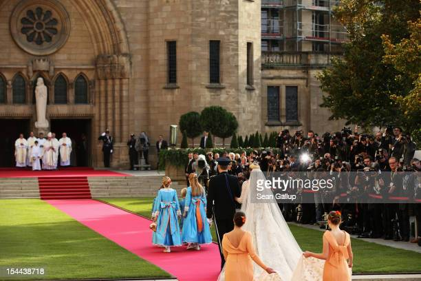 Princess Stephanie of Luxembourg is led by Count Jehan of Louxembourg to the wedding ceremony of Prince Guillaume of Luxembourg and Princess...