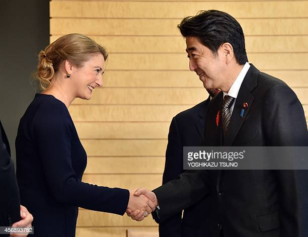 Princess Stephanie of Luxembourg wife of Luxembourg's Crown Prince Guillaume shakes hands with Japanese Prime Minister Shinzo Abe at Abe's office in...