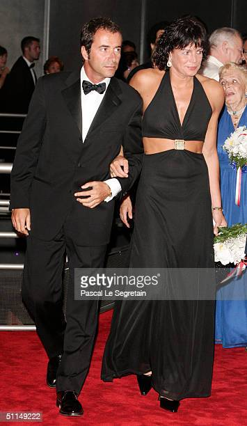 Princess Stephanie of Monaco and Bernard Montiel arrive at the Monte Carlo Red Cross Ball 2004 held at the Salle des Etoiles of the Monaco Sporting...