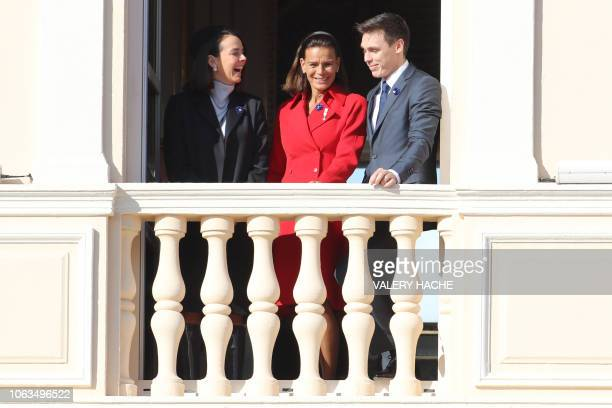 Princess Stephanie of Monaco and her children Pauline Ducruet and Louis Ducruet appear on the balcony of the Monaco Palace during the celebrations...