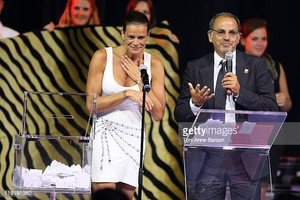 HSH Princess Stephanie of Monaco and host Marc Toesca during the Tombola Drawing at the FightAids Monaco Summer Gala at the Monte Carlo Sporting Club...