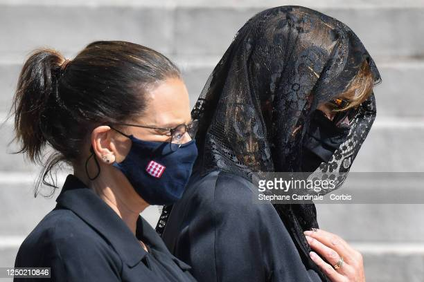 Princess Stephanie of Monaco and Princess Caroline of Hanover arrive at the Monaco Cathedral for Elizabeth-Ann De Massy's Funerals on June 17, 2020...