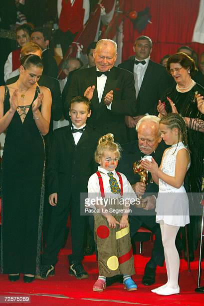 Princess Stephanie of Monaco applauds her children Louis Camille and Pauline as they present an award to their grandfather Prince Rainier III at the...