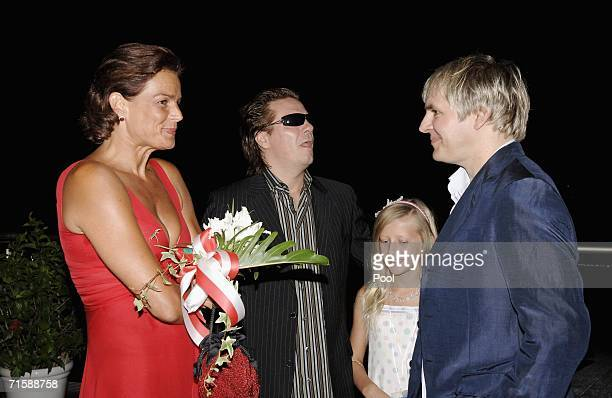 Princess Stephanie of Monaco musicians Andy Taylor with his daughter and Nick Rhodes of Duran Duran attend a cocktail reception at the Monaco Red...