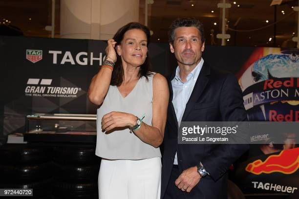 Princess Stephanie of Monaco poses with TAG Heuer Ambassador and actor Patrick Dempsey, during a visit to the Car Collection of Prince Albert of...