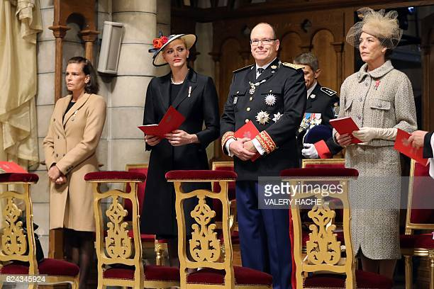 Princess Stephanie of Monaco, Princess Charlene of Monaco, Prince Albert II of Monaco and Princess Caroline of Hanover attend a mass at the Saint...