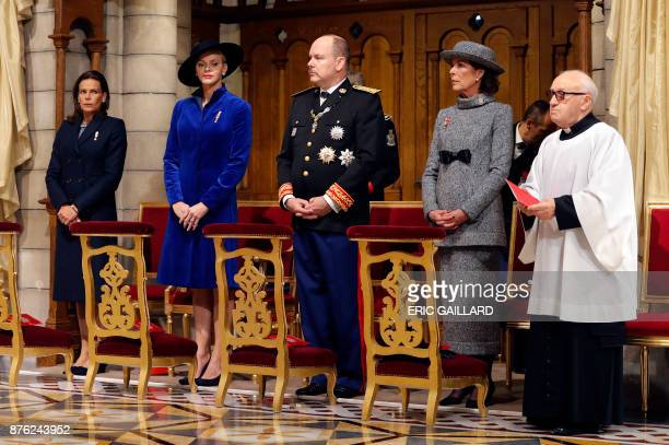 Princess Stephanie of Monaco Princess Charlene of Monaco Prince Albert II of Monaco and Princess Caroline of Hanover attend a mass at the Saint...