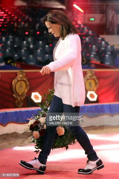 Princess Stephanie of Monaco walks with a bouquet of flowers she received for her 53rd birthday on the opening of the 7th MonteCarlo International...