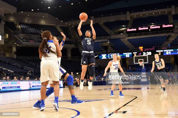 Princess Stewart of the Xavier Musketeers takes a jump shot during a women's college basketball game against the DePaul Blue Demons at Wintrust Arena...