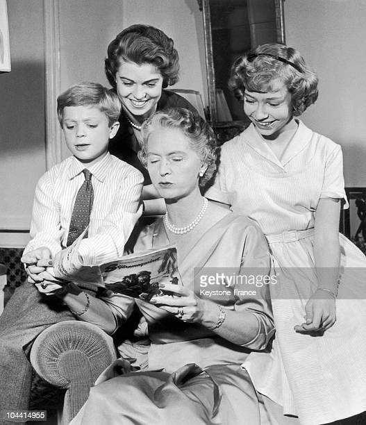 Princess SYBILLA of Sweden reading a magazine for her children Crown prince CARL GUSTAF princesses MARGARETHA and CHRISTINA around 1955