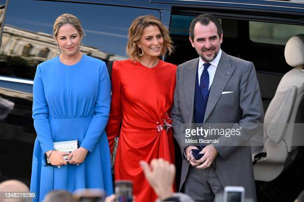 Princess Theodora, Princess Tatiana and Prince Nikolaos arrive at the Athens Orthodox Cathedral following the wedding ceremony of Nina Flohr and...
