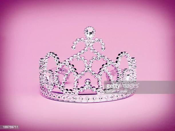 Princess tiara on pink background
