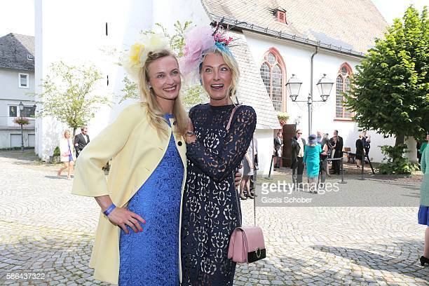 Princess Vanessa zu Sayn-Wittgenstein and her sister Prinzessin Lilly zu Sayn-Wittgenstein-Berleburg make fun during the wedding of Prince Maximilian...