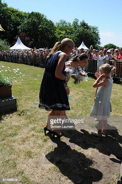 Princess Victoria and Princess Madeleine speak to children as they attend The Sigvard Bernadotte Exhibition at Sofiero on June 7 2008 in Helsingborg...