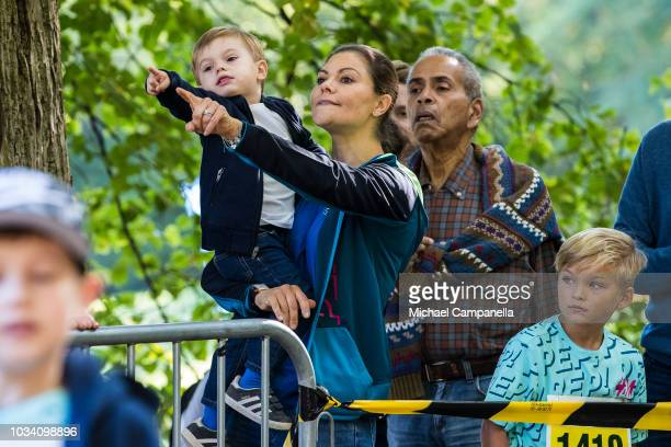 Princess Victoria of Sweden and Prince Oscar of Sweden look on as children compete during the Prince Daniels Race and Pep Day at Haga Park on...