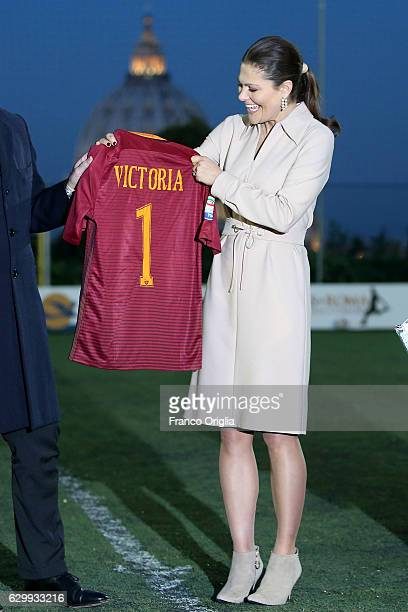 Princess Victoria of Sweden poses with a AS Roma football shirt as The Swedish Crown Couple and Minister Ekstrom visit AS Roma at the St Peter's...
