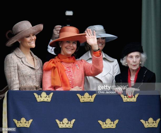 Princess Victoria of Sweden, Queen Silvia of Sweden, Princess Madeleine of Sweden and Princess Lilian of Sweden stand on the balcony during the...