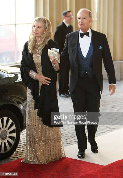 Princess Yasmina Aga Khan the Aga Khan's half sister and Prince Amyn Aga Khan his brother arrive at Buckingham Palace to attend a dinner to mark the...