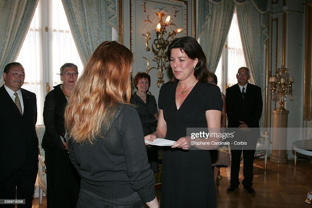 HRH Princesse Caroline of Hanover presents Yasmine Ghata with her Research award (Laureat de la Bourse de la Decouverte) during the Prince Pierre of Monaco Foundation award ceremony.
