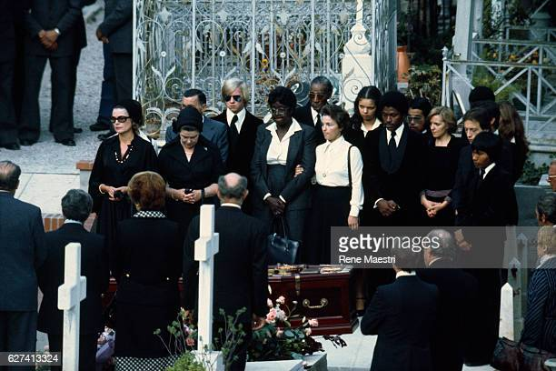 Princesse Grace of Monaco attends the burial of American singer Josephine Baker at the Monaco cemetery The singer's adopted children are also in...