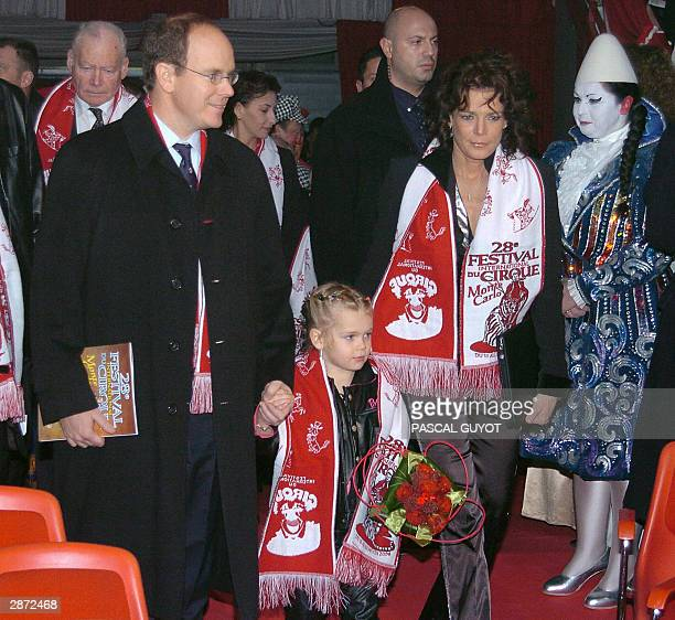 Princesse Stephanie of Monaco and Prince Albert of Monaco holding the hand of Stephanie daughter Camille arrive 15 January 2004 for the 28th...