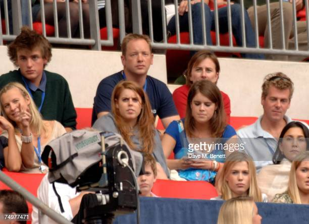 Princesses Beatrice and Eugenie attend the Concert For Diana at Wembley Stadium July 1 2007 in London England The concert marks the 10th anniversary...
