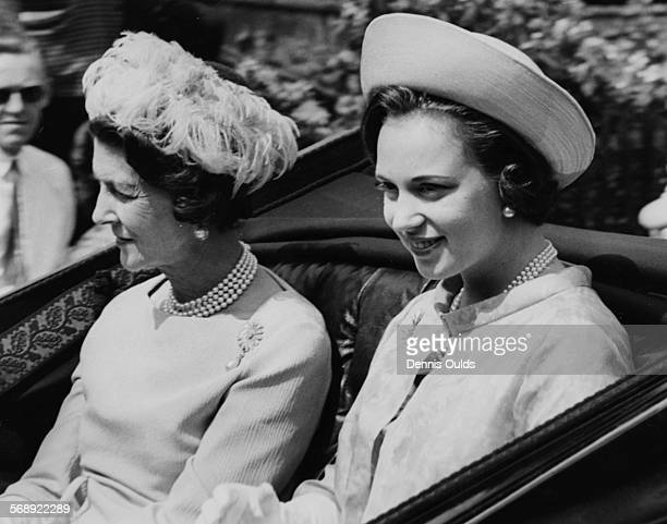 Princesses Benedikte and Marina smiling as they ride in a open carriage on their way to Royal Ascot England June 14th 1966