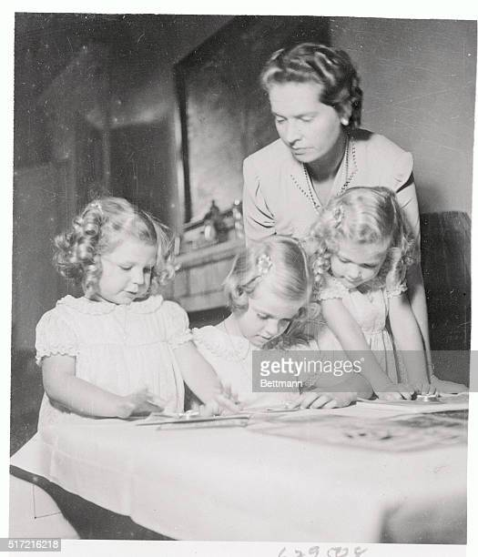 Princesses Desiree, Margaretha, and Birgitta, are shown with their mother, Princess Sibylla, the wife of Prince Gustaf Adolf. The photograph was...