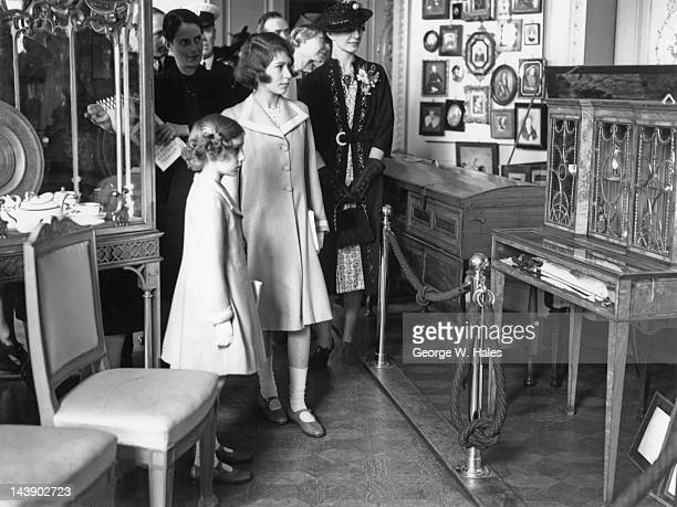 Princesses Elizabeth and Margaret at an exhibition of royal treasures at 145 Piccadilly London 28th July 1939 On the right is Elizabeth's governess...